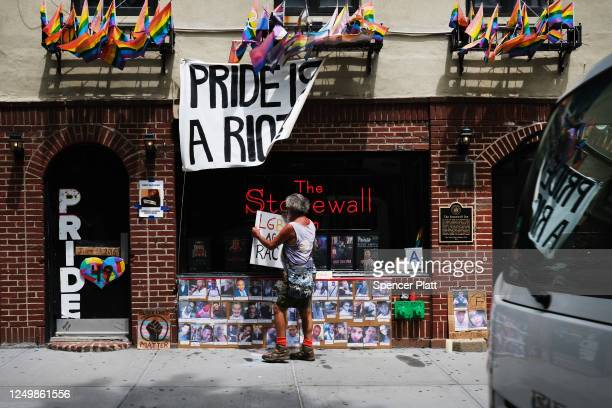 Memorial stands outside of the historic LGBT bar The Stonewall Inn to the victims of the Pulse night club shooting in Manhattan's West Village on...