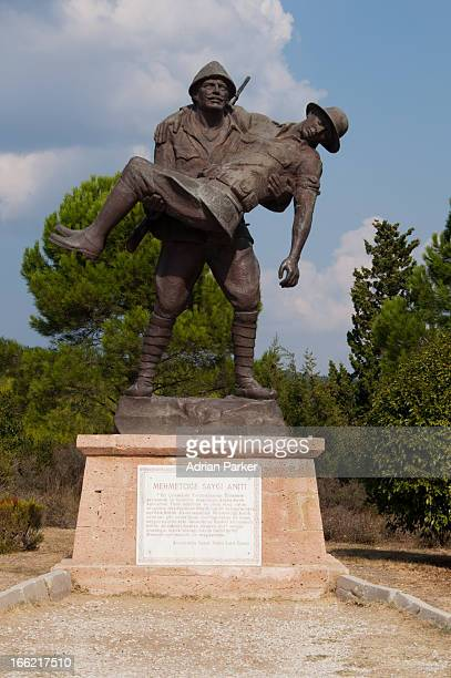 Memorial statue of a Turkish soldier carrying an injured Anzac soldier on the Gallipoli battlefields.