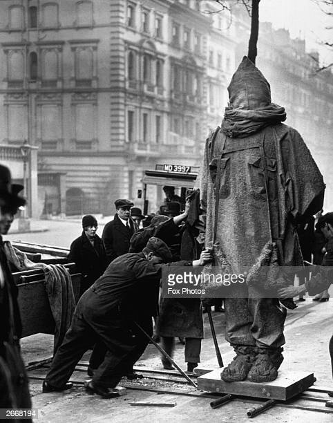 A memorial statue of arctic explorer Sir Ernest Henry Shackleton by Charles Jagger arrives at the Royal Geographical Society headquarters in...