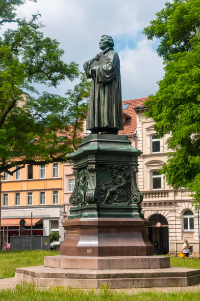 Memorial statue of Martin Luther against building at Karlsplatz Square in Eisenach, Germany