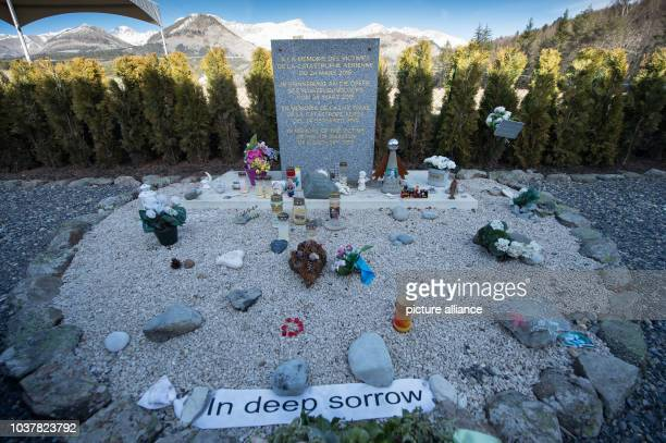 A memorial stele that reads 'In memory of the victims of the air disaster of March 24th 2015' in four languages pictured near the Col de Mariaud area...