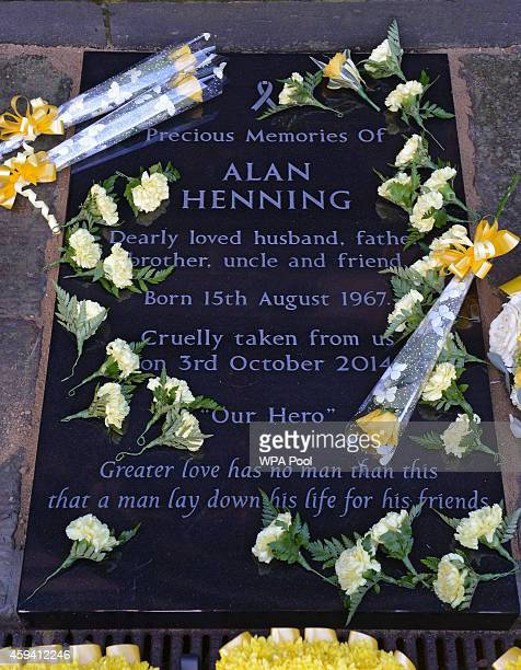 A memorial stone is unveiled in memory of murdered British aid worker Alan Henning at Eccles Parish Church on November 22 2014 in Manchester United...