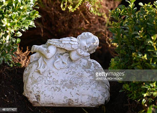 A memorial stone reading Rest in Peace lays on a grave that was opened on January 8 2014 in connection with the case of a girl missed since the year...