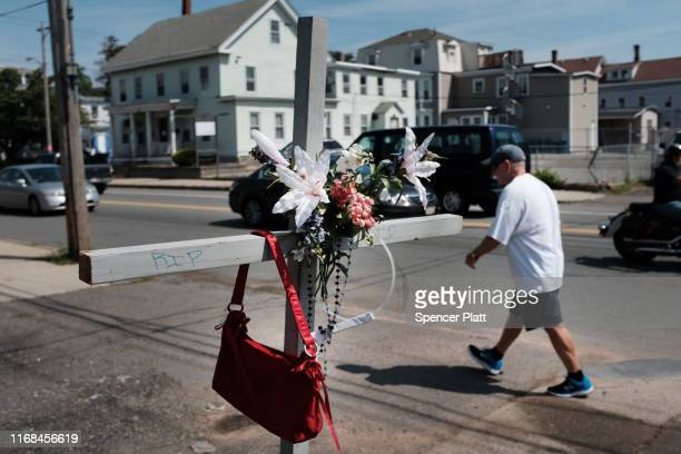 A memorial to a woman stands along a street on August 16 2019 in Lawrence Massachusetts Lawrence once one of America's great manufacturing cities...