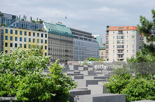 Memorial to the murdered Jews of Europe. Berlin, Germany. Some residential buildings can be seen above the cited monument.