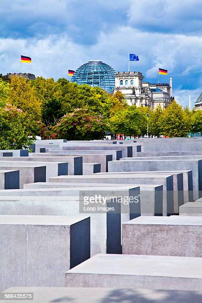 Memorial to the Murdered Jews of Europe or Holocaust Memorial with the Reichstag Dome in the distance in Berlin