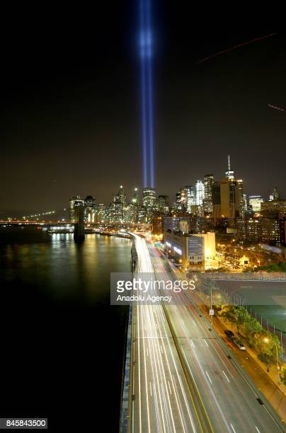 Memorial 'Tribute in Light' is seen in Manhattan skyline from Brooklyn Bridge Park in Brooklyn New York USA on September 11 2017 on a day of the 16th...