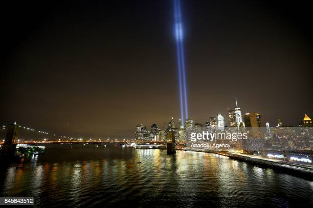 Memorial Tribute in Light is seen in Manhattan skyline from Brooklyn Bridge Park in Brooklyn New York USA on September 11 2017 on a day of the 16th...
