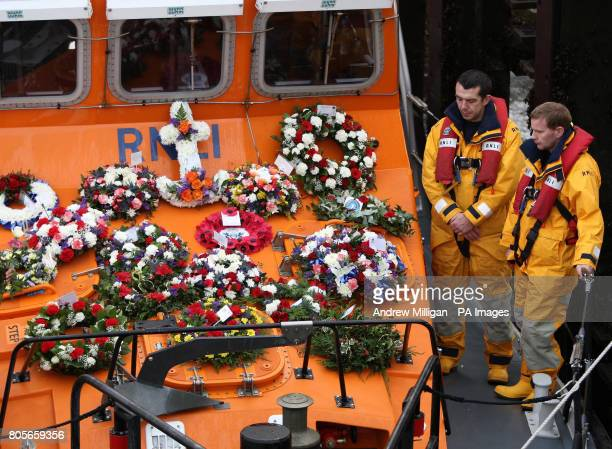 Memorial wreaths are taken out to sea on board the Earl and Countess Mountbatten of Burma lifeboat to mark 50 years since the deaths of eight RNLI...