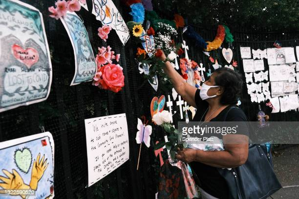 Memorials hang from the front gate of Greenwood Cemetery during an event and procession organized by Naming the Lost Memorials to remember and...