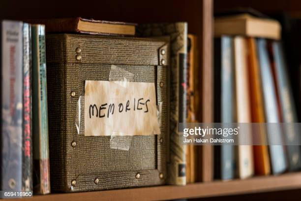 memories box in book shelf - ricordi foto e immagini stock