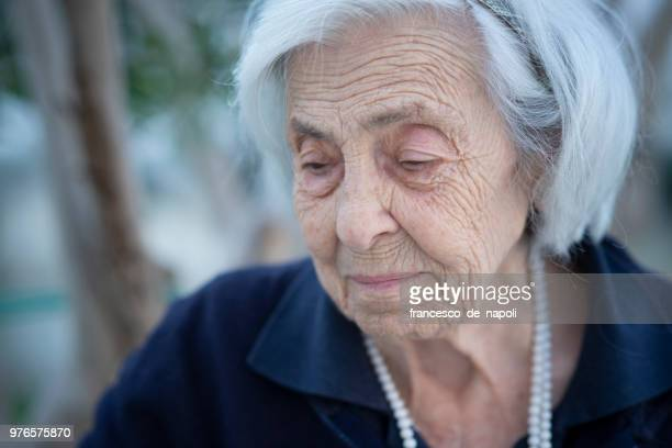 memories of an elderly lady - vulnerability stock photos and pictures