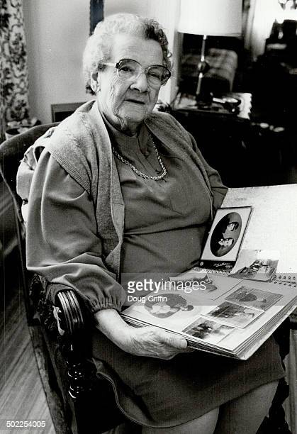Memories rekindled Ellen Higgins 88 of Brantford Ont looks through her photo album as she eagerly awaits reunion with sister Rose 83 whom she hasn't...