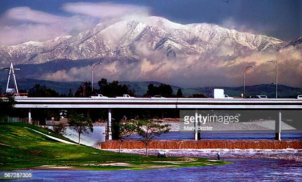 MEMountainsSnow022098MB–––Mount Baldy and the San Gabriel Mountains glisten in the morning sun after an overnight storm dumped rain in the lower...