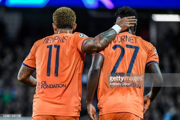 Memphis Depay and Maxwel Cornet of Lyon celebrate a goal during the Champions League match between Manchester City and Lyon at Etihad Stadium on...