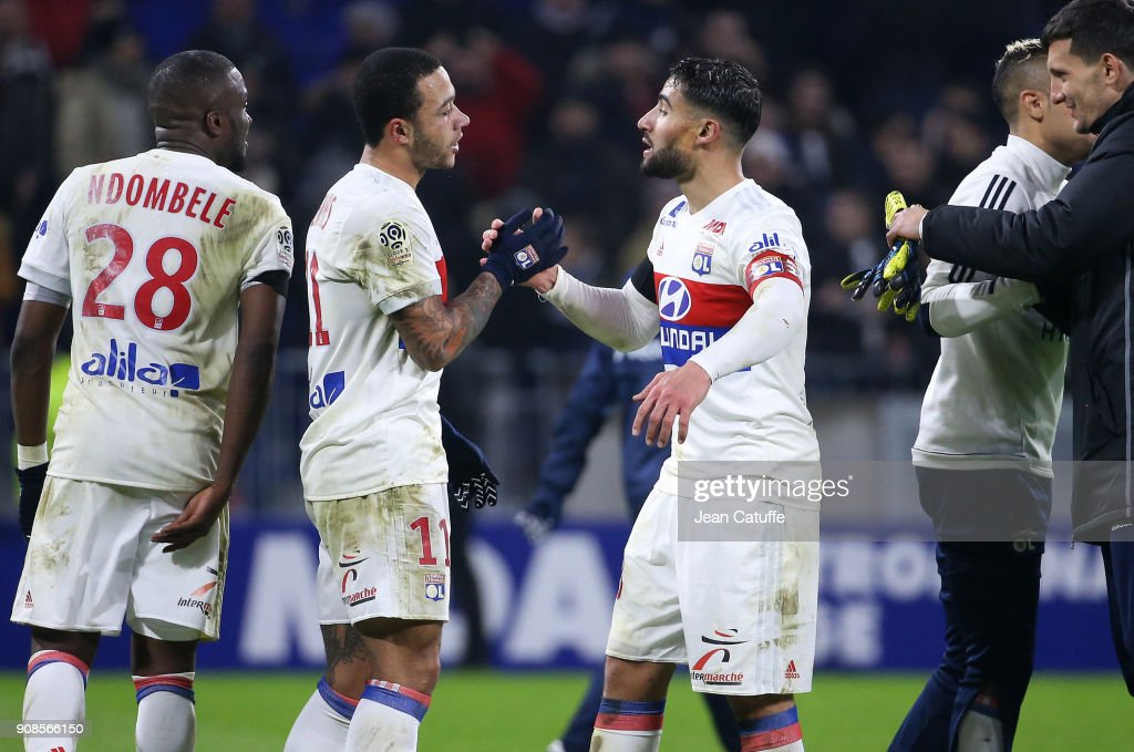 Memphis Depay and Nabil Fekir of Lyon celebrate the victory following the French Ligue 1 match between Olympique Lyonnais (OL) and Paris Saint Germain (PSG) at Groupama Stadium on January 21, 2018 in Lyon, France.