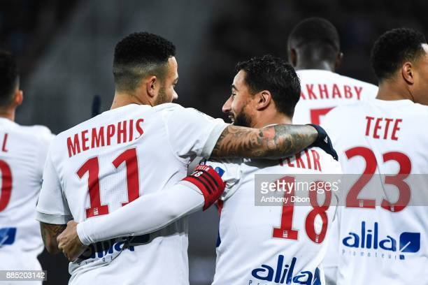 Memphis Depay and Nabil Fekir of Lyon celebrates a goal during the Ligue 1 match between SM Caen and Olympique Lyonnais at Stade Michel D'Ornano on...