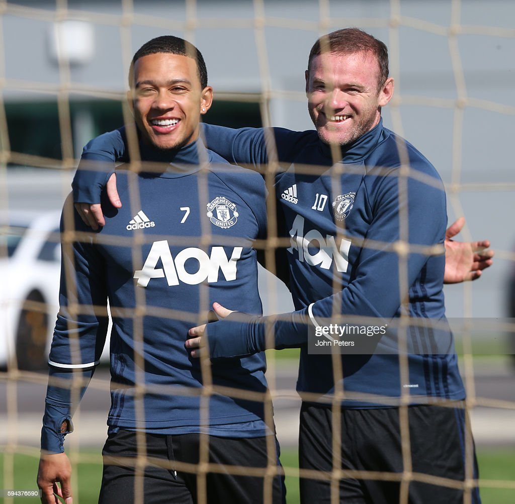 Memphis Depay and Wayne Rooney of Manchester United in action during a first team training session at Aon Training Complex on August 23, 2016 in Manchester, England.