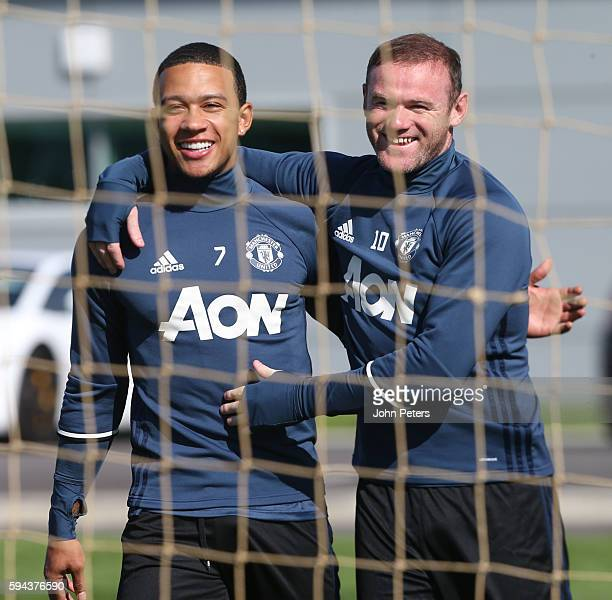 Memphis Depay and Wayne Rooney of Manchester United in action during a first team training session at Aon Training Complex on August 23 2016 in...