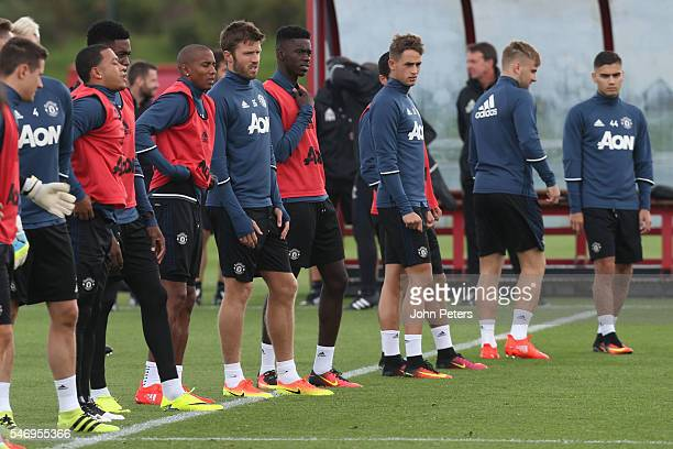 Memphis Depay Ashley Young Michael Carrick Adnan Januzaj Henrikh Mkhitaryan and Luke Shaw of Manchester United in action during a first team training...
