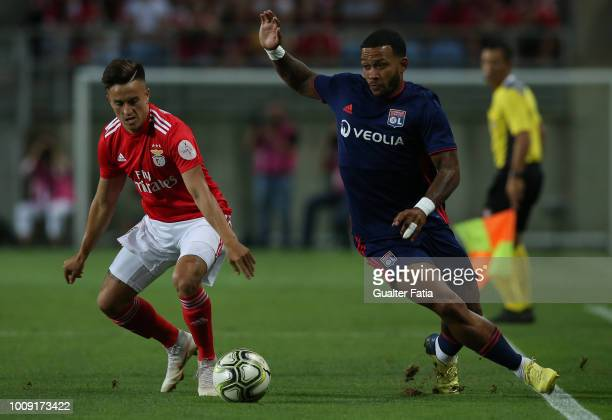Memphis Depay from Lyon with Franco Cervi from SL Benfica in action during the International Champions Cup match between SL Benfica and Lyon at...