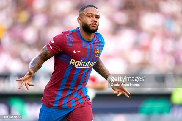 Memphis Depay of Barcelona celebrates after scoring his team's first goal during a pre-season friendly match between VfB Stuttgart and FC Barcelona...