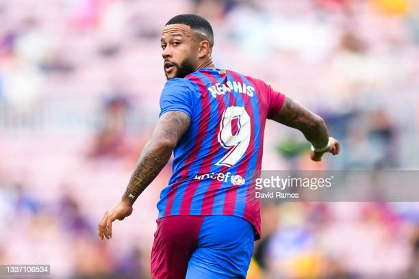 Memphis Depay of FC Barcelona looks on during the La Liga Santader match between FC Barcelona and Getafe CF at Camp Nou on August 29, 2021 in...