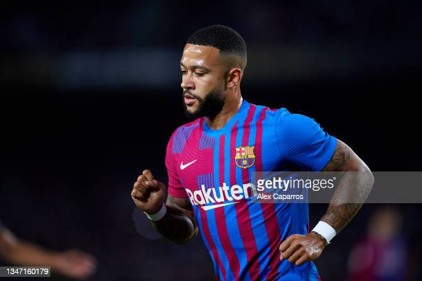 Memphis Depay of FC Barcelona looks on during the LaLiga Santander match between FC Barcelona and Valencia CF at Camp Nou on October 17, 2021 in...