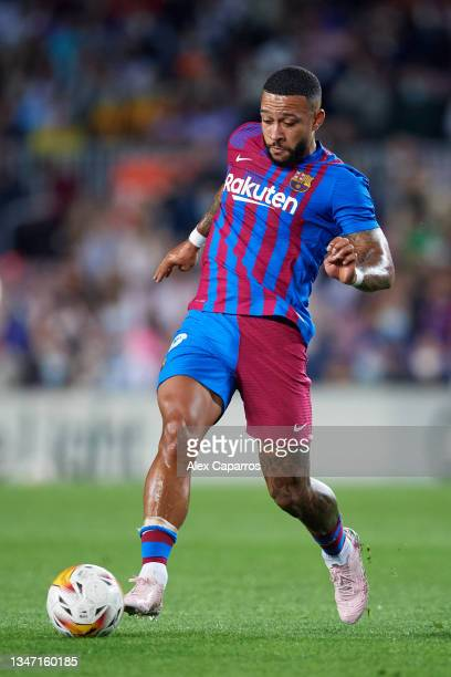 Memphis Depay of FC Barcelona runs with the ball during the LaLiga Santander match between FC Barcelona and Valencia CF at Camp Nou on October 17,...