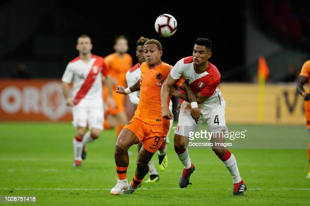 Memphis Depay of Holland Anderson Santamaria of Peru during the International Friendly match between Holland v Peru at the Johan Cruijff Arena on...