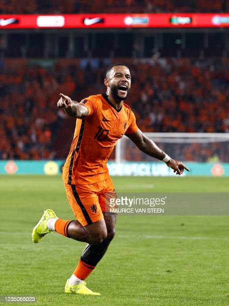 Memphis Depay of Holland celebrates scoring his second goal during the World Cup qualifier football match between the Netherlands and Montenegro on...