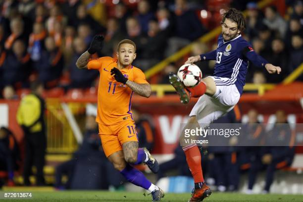 Memphis Depay of Holland Charlie Mulgrew of Scotland during the friendly match between Scotland and The Netherlands on November 09 2017 at Pittodrie...