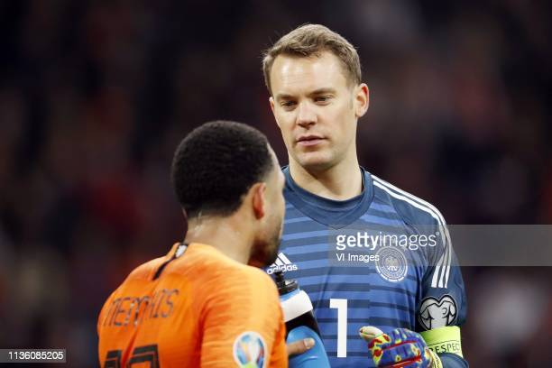 Memphis Depay of Holland Germany goalkeeper Manuel Neuer during the UEFA EURO 2020 qualifier group C qualifying match between The Netherlands and...