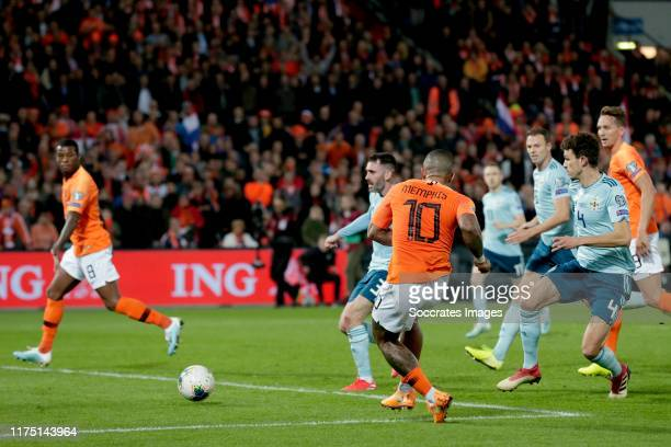 Memphis Depay of Holland scores the fourth goal to make it 3-1 during the EURO Qualifier match between Holland v Northern Ireland at the Feijenoord...