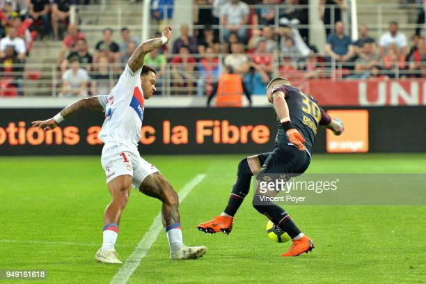 Memphis DEPAY of Lyon and Baptiste REYNET of Dijon during the Ligue 1 match between Dijon FCO and Olympique Lyonnais at Stade Gaston Gerard on April...