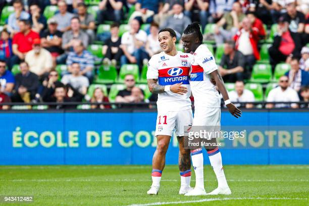 Memphis Depay of Lyon and Bertrand Traore of Lyon celebrates scoring his goal during the Ligue 1 match between Metz and Olympique Lyonnais at on...