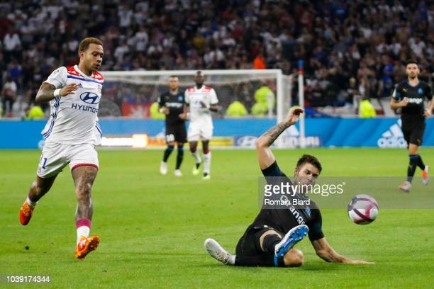 Memphis Depay of Lyon and Duje Caleta Car of Marseille during the Ligue 1 match between Lyon and Marseille at Parc Olympique on September 23 2018 in...
