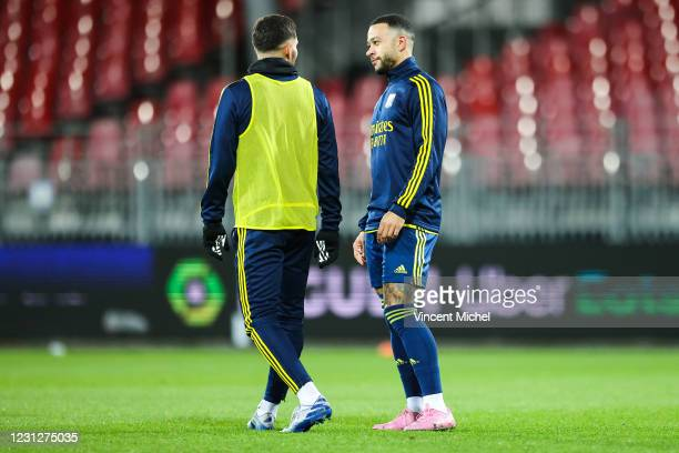 Memphis Depay of Lyon and Houssem Aouar of Lyon during the Ligue 1 soccer match between Stade Brestois 29 and Olympique Lyonnais at Francis-Le Ble...