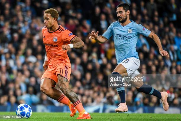 Memphis Depay of Lyon and Ilkay Gundogan of Manchester City during the Champions League match between Manchester City and Lyon at Etihad Stadium on...