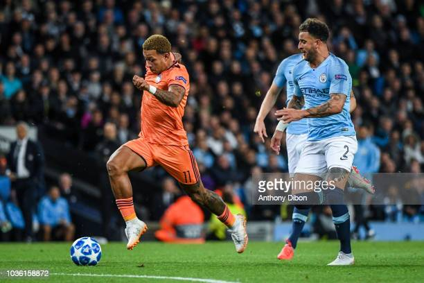 Memphis Depay of Lyon and Kyle Walker of Manchester City during the Champions League match between Manchester City and Lyon at Etihad Stadium on...