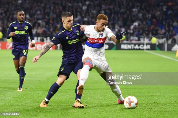 Memphis Depay of Lyon and Muhamed Besic of Everton during the Europa League match between Lyon and Everton at Groupama Stadium on November 2 2017 in...