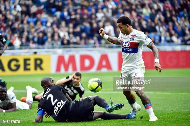 Memphis Depay of Lyon and Prince Desir Gouano of Amiens during the Ligue 1 match between Lyon and Amiens at Parc Olympique on April 14 2018 in Lyon