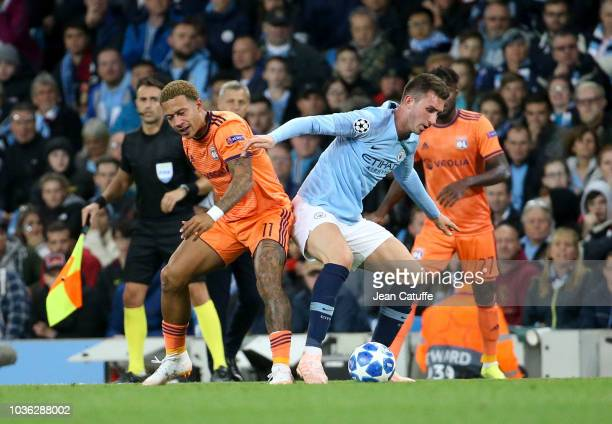 Memphis Depay of Lyon Aymeric Laporte of Manchester City during the Group F match of the UEFA Champions League between Manchester City and Olympique...