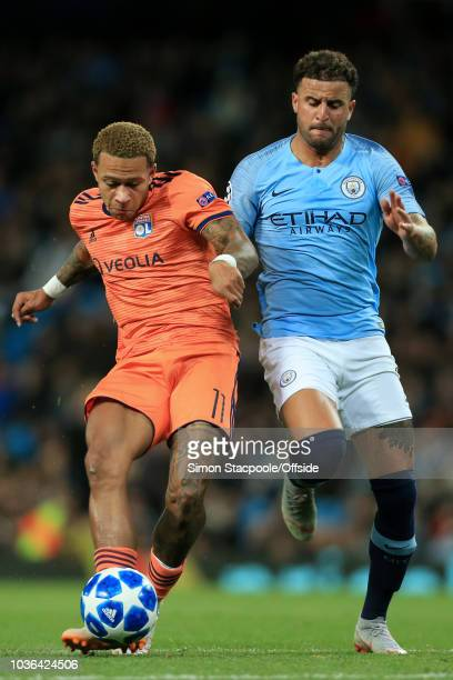 Memphis Depay of Lyon battles with Kyle Walker of Man City during the Group F match of the UEFA Champions League between Manchester City and...
