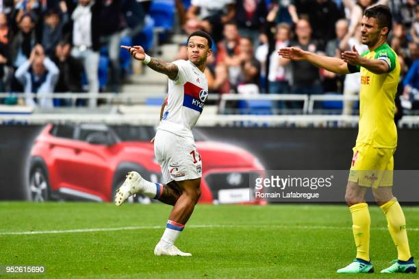 Memphis Depay of Lyon celebrates after scoring a goal during the Ligue 1 match between Olympique Lyonnais and Nantes at Parc Olympique on April 28...