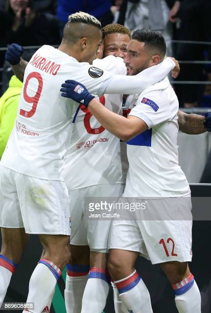 Memphis Depay of Lyon celebrates his goal between Mariano Diaz and Jordan Ferri during the UEFA Europa League group E match between Olympique...