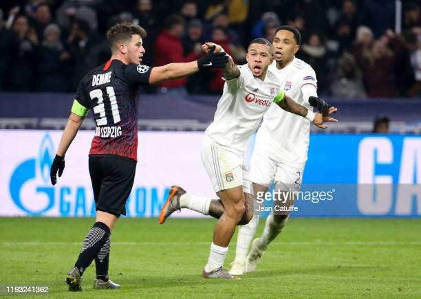 Memphis Depay of Lyon celebrates his goal tying the game at 22 during the UEFA Champions League group G match between Olympique Lyonnais and RB...