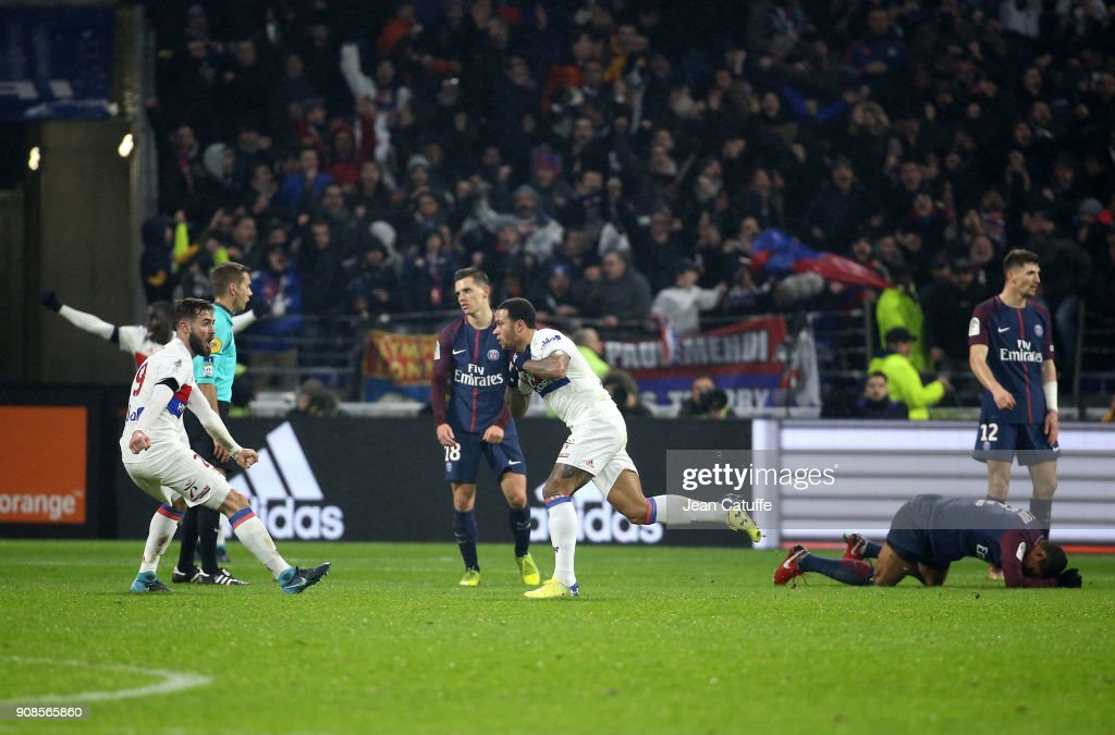 Memphis Depay of Lyon celebrates his winning goal at the last minute with Lucas Tousart (left) during the French Ligue 1 match between Olympique Lyonnais (OL) and Paris Saint Germain (PSG) at Groupama Stadium on January 21, 2018 in Lyon, France.