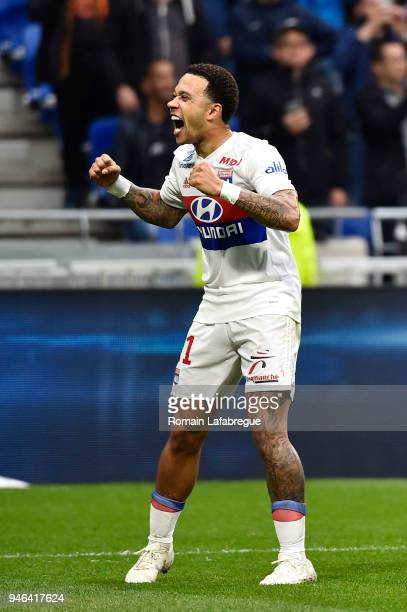 Memphis Depay of Lyon celebrates scoring during the Ligue 1 match between Lyon and Amiens at Parc Olympique on April 14 2018 in Lyon
