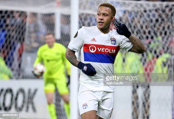 Memphis Depay of Lyon celebrates scoring the third goal during the UEFA Europa League group E match between Olympique Lyonnais and Everton FC at...